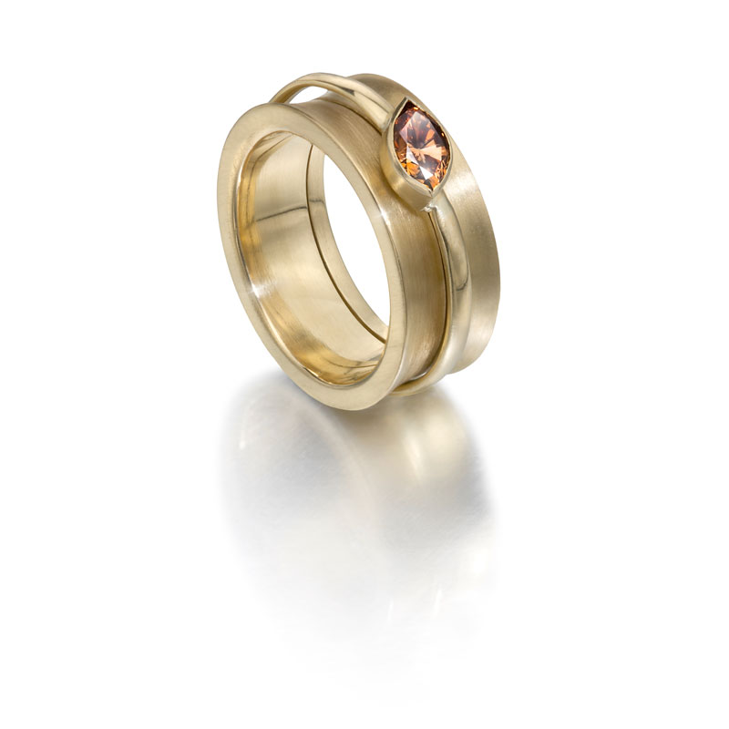 18ct gold outer ring, 18ct gold inner ring with cognac diamond