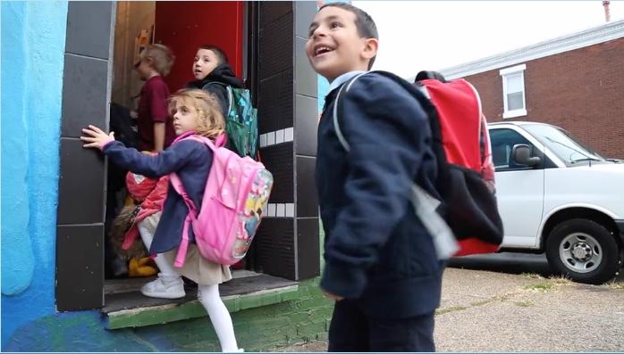 Children happily running into class.