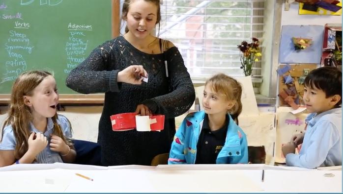 A teacher going over materials in class.