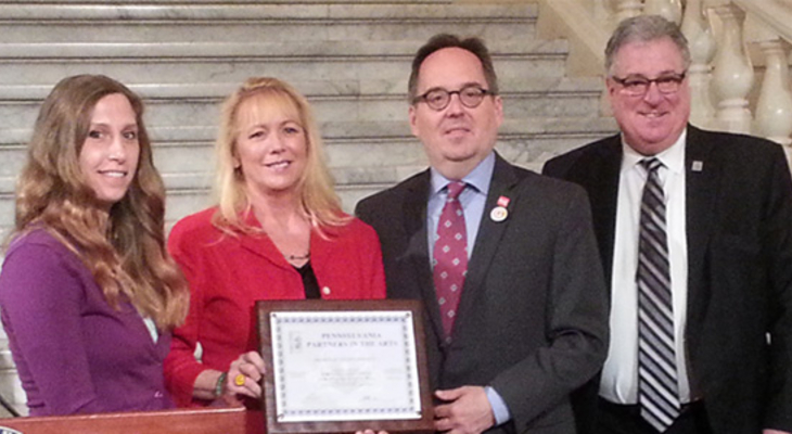 Assosciate Director Jenna Wilchinsky and Director Kim Creighton receiving their award from Michael Norris, Interim Executive Director of the Cultural Alliance and Philip Horn, Executive Director of Pennsylvania Council on the Arts