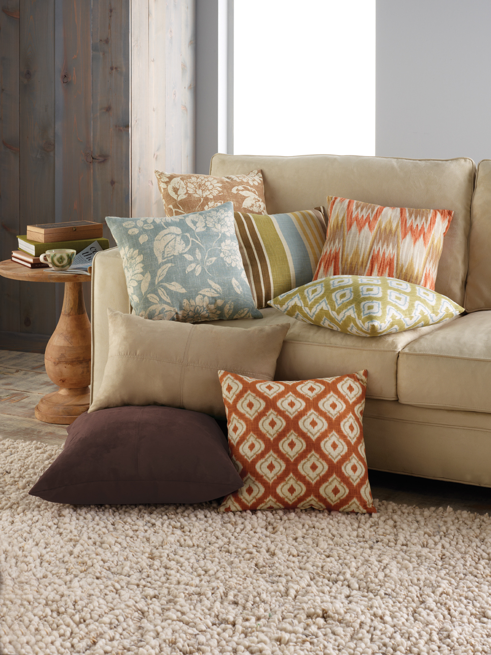 - Throws and Pillows -Adding soft throw blankets and pillows to your couch and chairs will instantly soften up the room. Don't be afraid to mix textures to make it even more inviting.