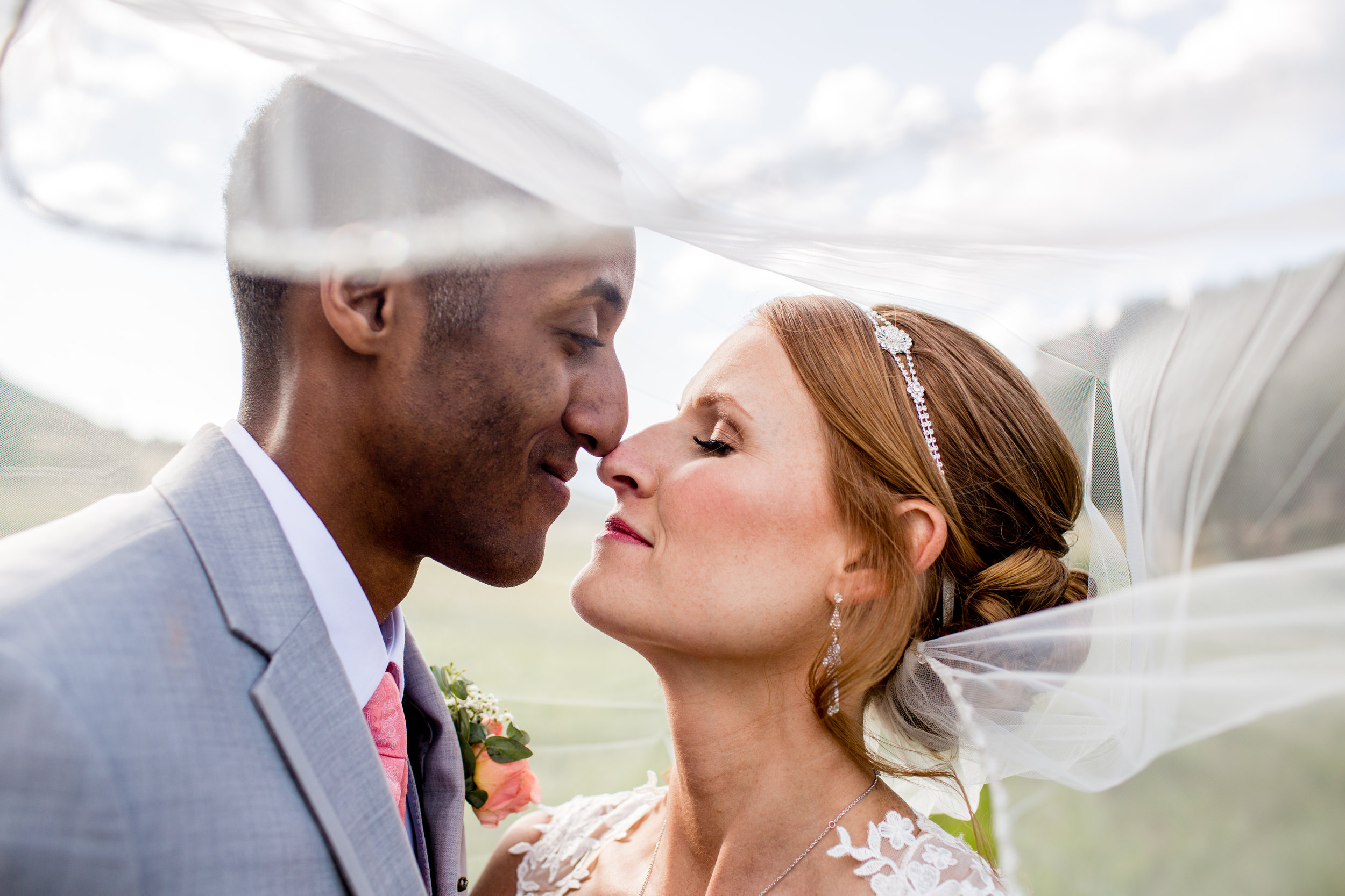 Absolutely LOVE veil shots like this! For Alli the veil was attached underneath her hairstyle, and boy that veil was not going anywhere, even in the wind!