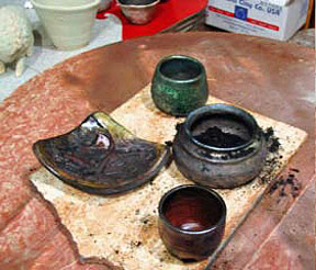 Fired Raku pots before cleaning off soot.jpg