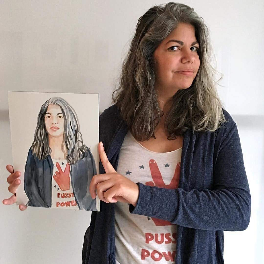 Curator Julie Torres with her portrait by artist Brenda Zlamany. Photo: Brenda Zlamany.
