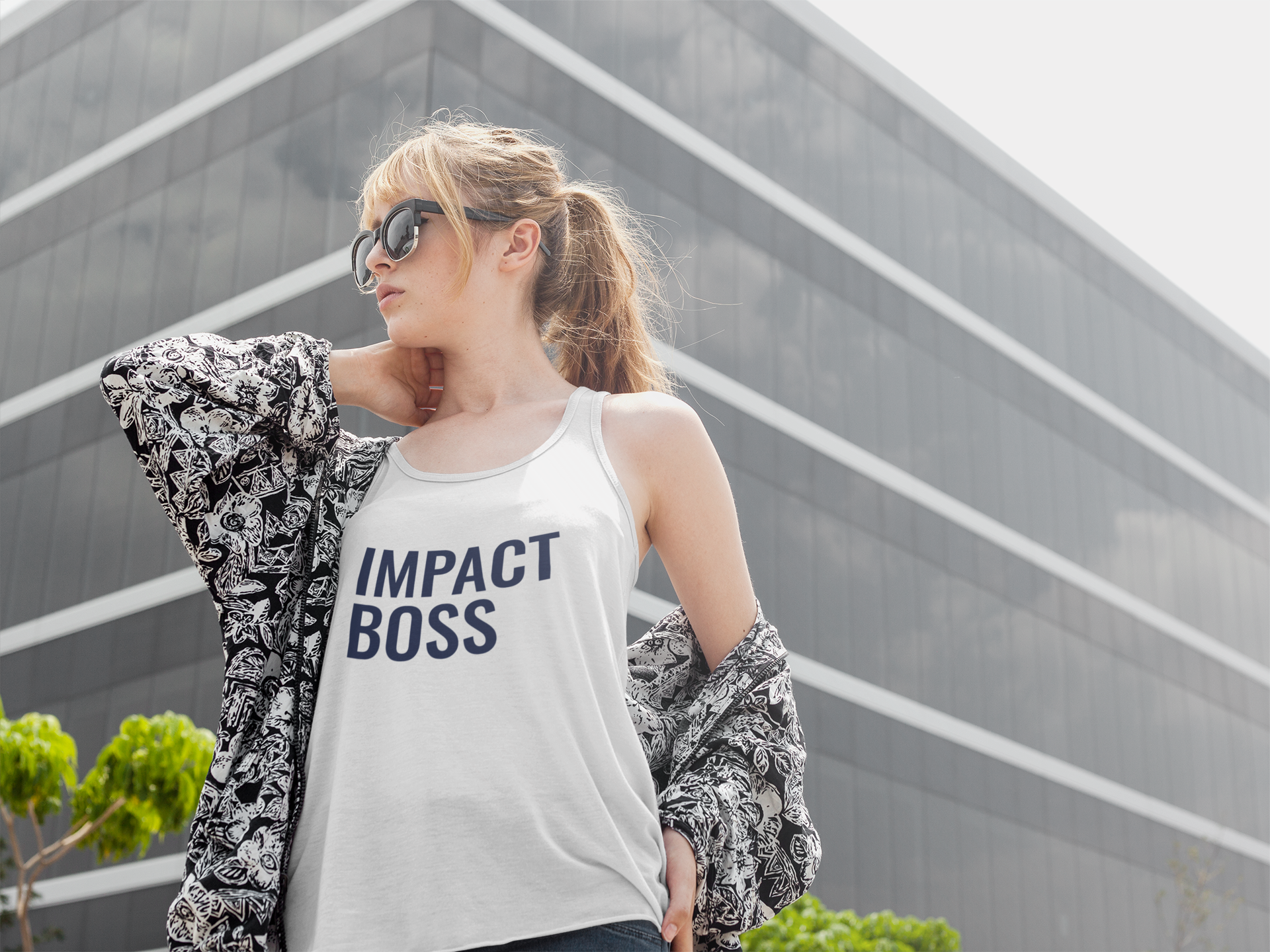 pretty-girl-wearing-a-bella-canvas-tank-top-mockup-while-walking-near-a-big-building-a16120.png