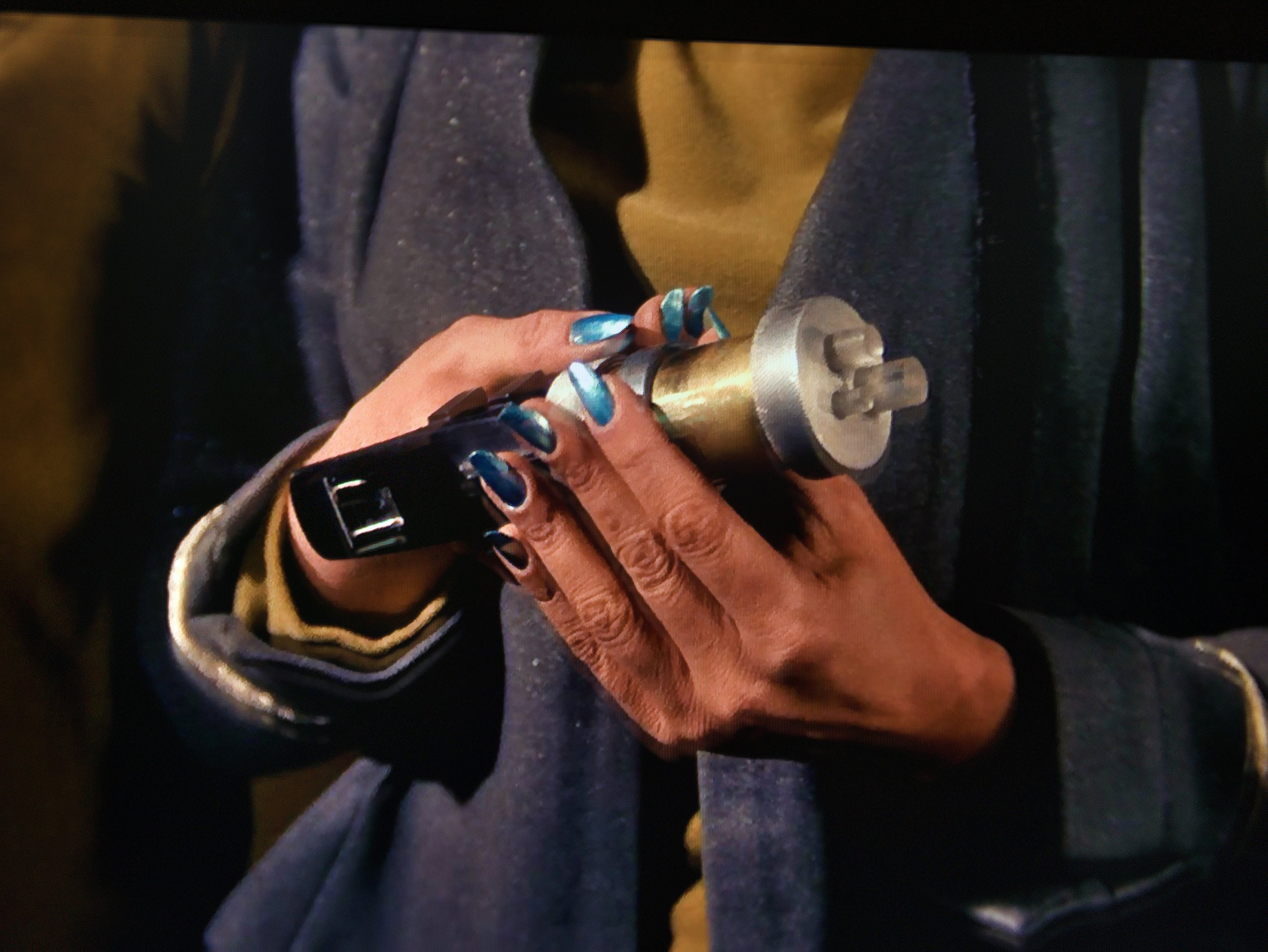 Number One cranks the phaser to ELEVEN. Also, please note her dazzling blue manicure—space aesthetic!
