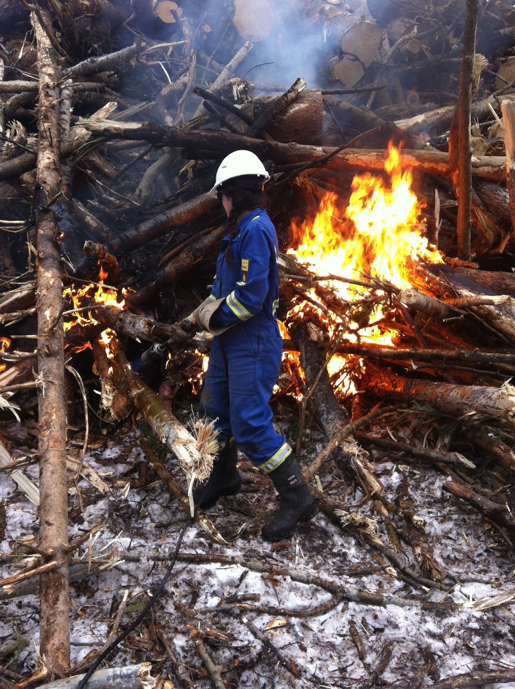 Me in coveralls using a tiger-torch to literally set the place on fire. Hilarious!