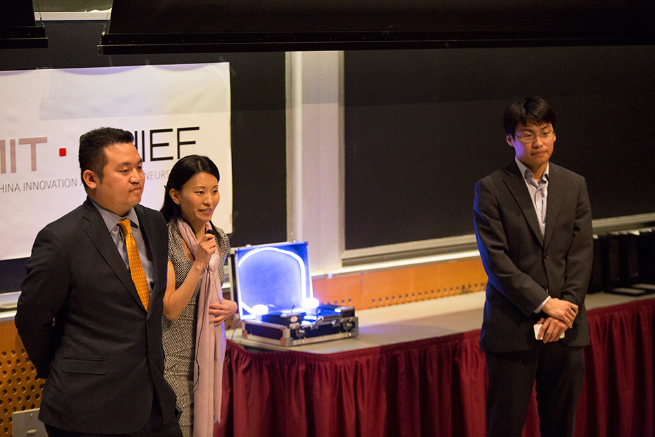BelLEDs Technologies team members (left to right) Patrick Lin, Xiaolu Li, and Michael Chen deliver their pitch, complete with a working prototype of their smart LEDs (center, in the suitcase) that illuminated to the sound of music.