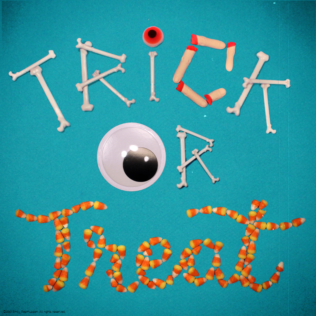 Trick or Treat lettering with Halloween toys and candy