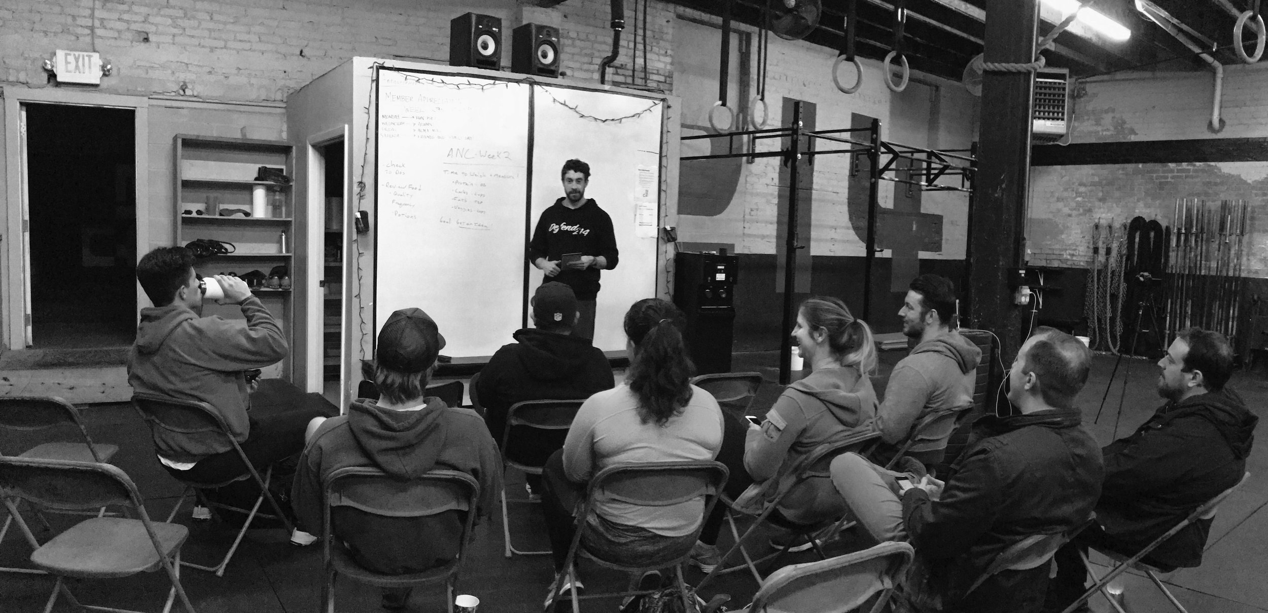 Teaching athletes at CrossFit 214 how to get the most out of their workouts, January 2017.