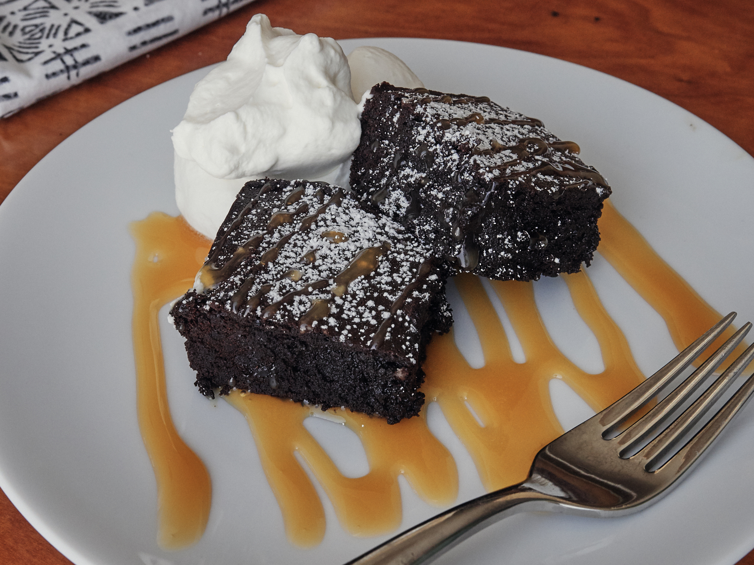 Serving Suggestion: Brownies, a sprinkle of powdered sugar, caramel sauce & whipped cream.