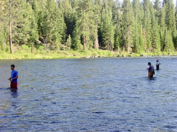 My sons (Andrew on the left and Ben on the far right) fishing with their dad on the Deschutes River in Oregon.