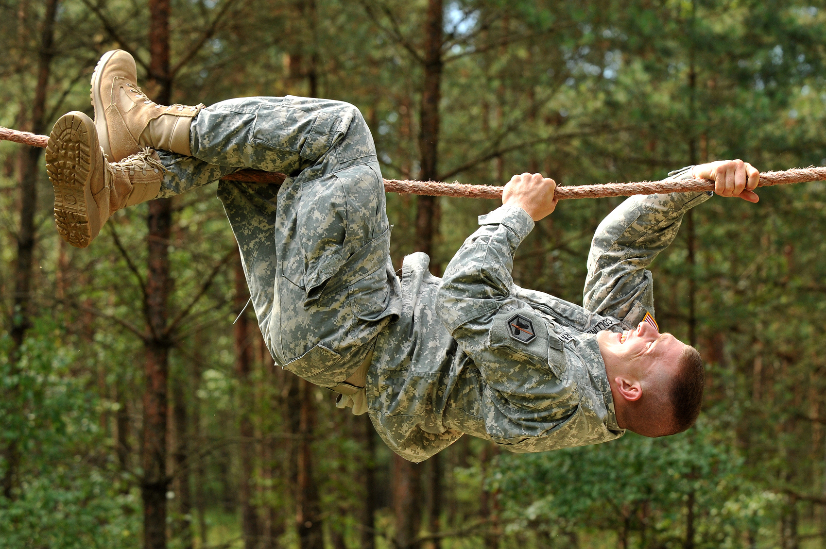 U.S. Army Sgt. Timothy Collins, 66th Military Intelligence Brigade, goes across the rope bridge at the obstacle course during United States Army Europe's Best Warrior Competition in Grafenwoehr, Germany, July 30, 2012. Image from  Wikimedia Commons  (U.S. Army photo by Visual Information Specialist Markus Rauchenberger/Released).