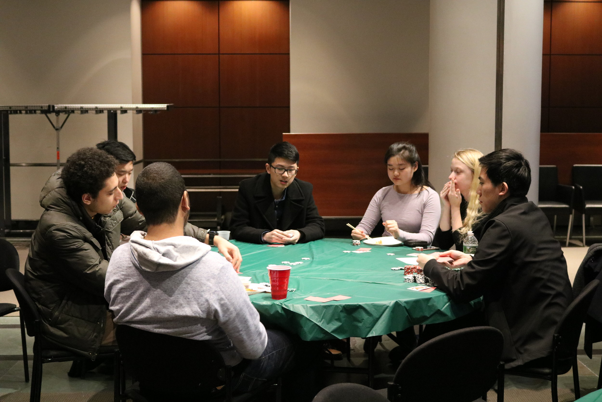 Group of Students Playing Poker