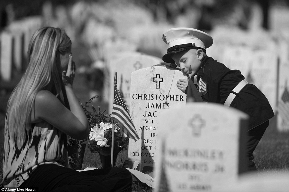 Mother and son visiting their fallen loved one -
