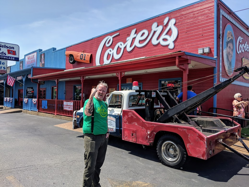 My husband John shows his appreciation for Cooter's Place — which, yes, was riiiight next to Willie Nelson's store and museum. At Willie's, you could buy tiny red headbands bearing braids made of brown yarn. You know, so that you can turn your infant into a miniature Willie Nelson.