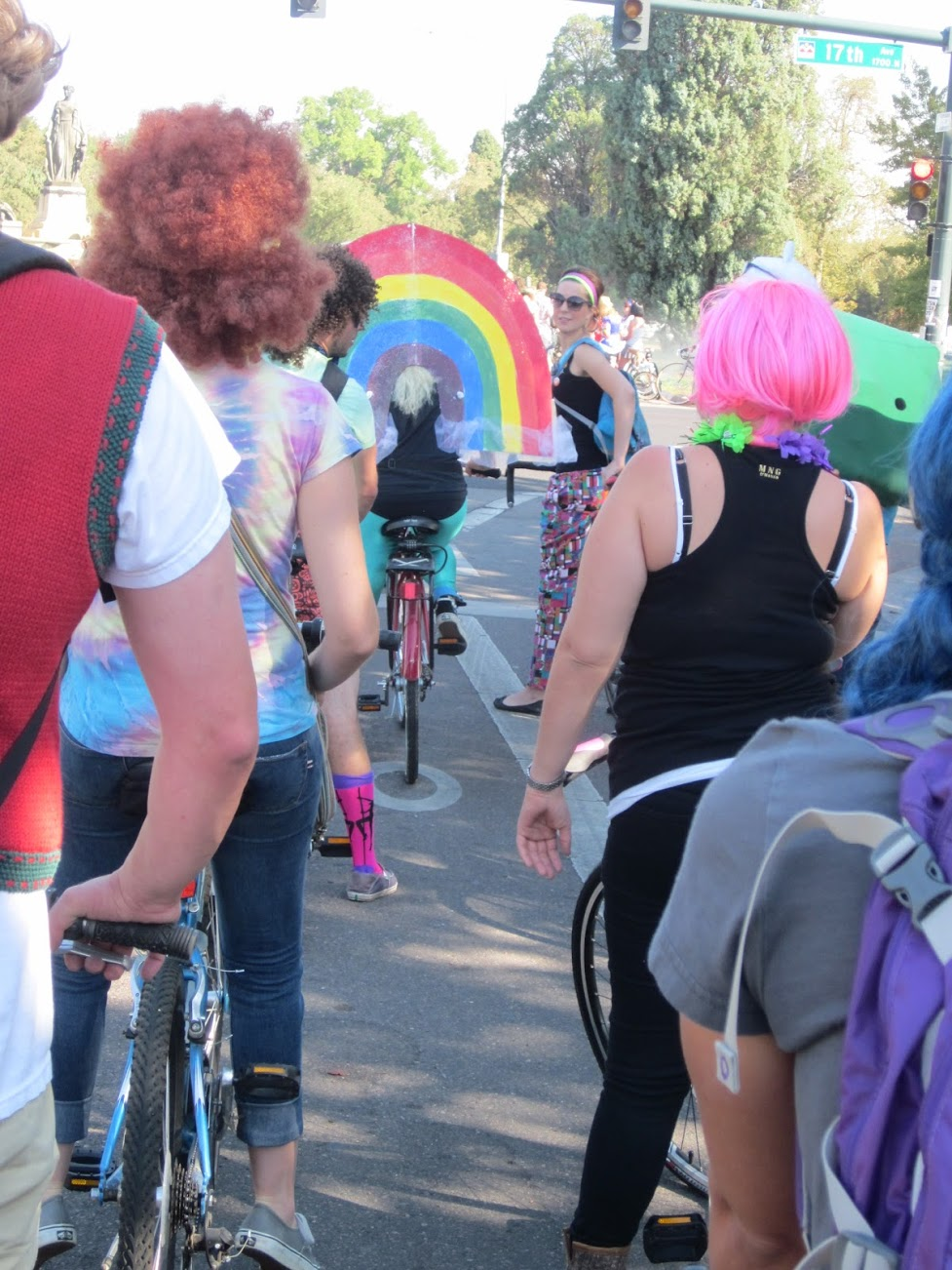 September 2012. Tour De Fat bicycle parade, City Park, Denver, Colorado. I realize I'm bending the rules with this one. Still, I want to celebrate this woman's ingenuity at creating a rainbow to follow her everywhere.
