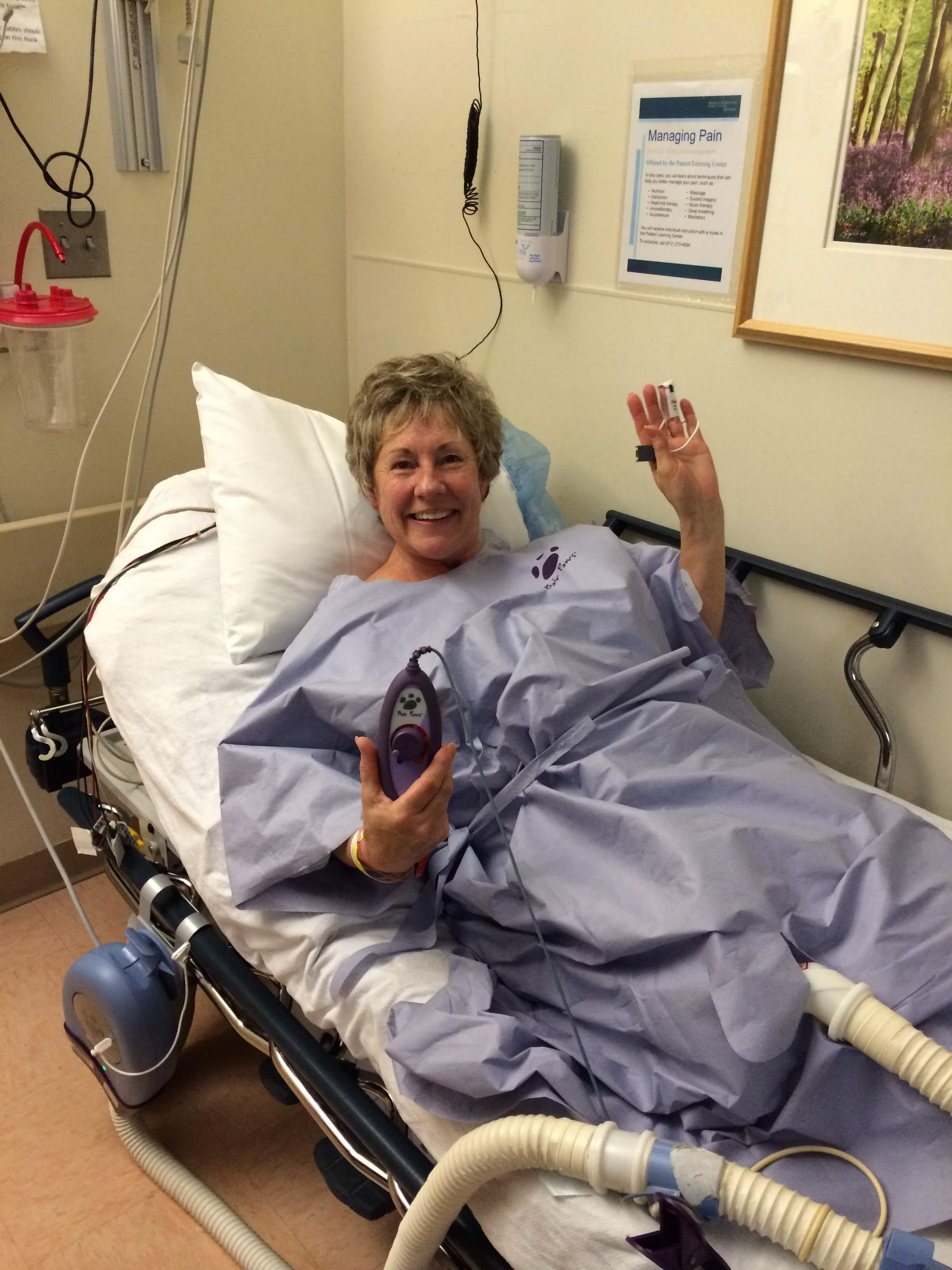 "This was my mom in the hospital preparing to have one of the lobes of her lung removed. Smiling before surgery. She made up a song about her tumor. It was to the tune of ""Itsy Bitsy Teenie Weenie Yellow Polka-Dot Bikini."""
