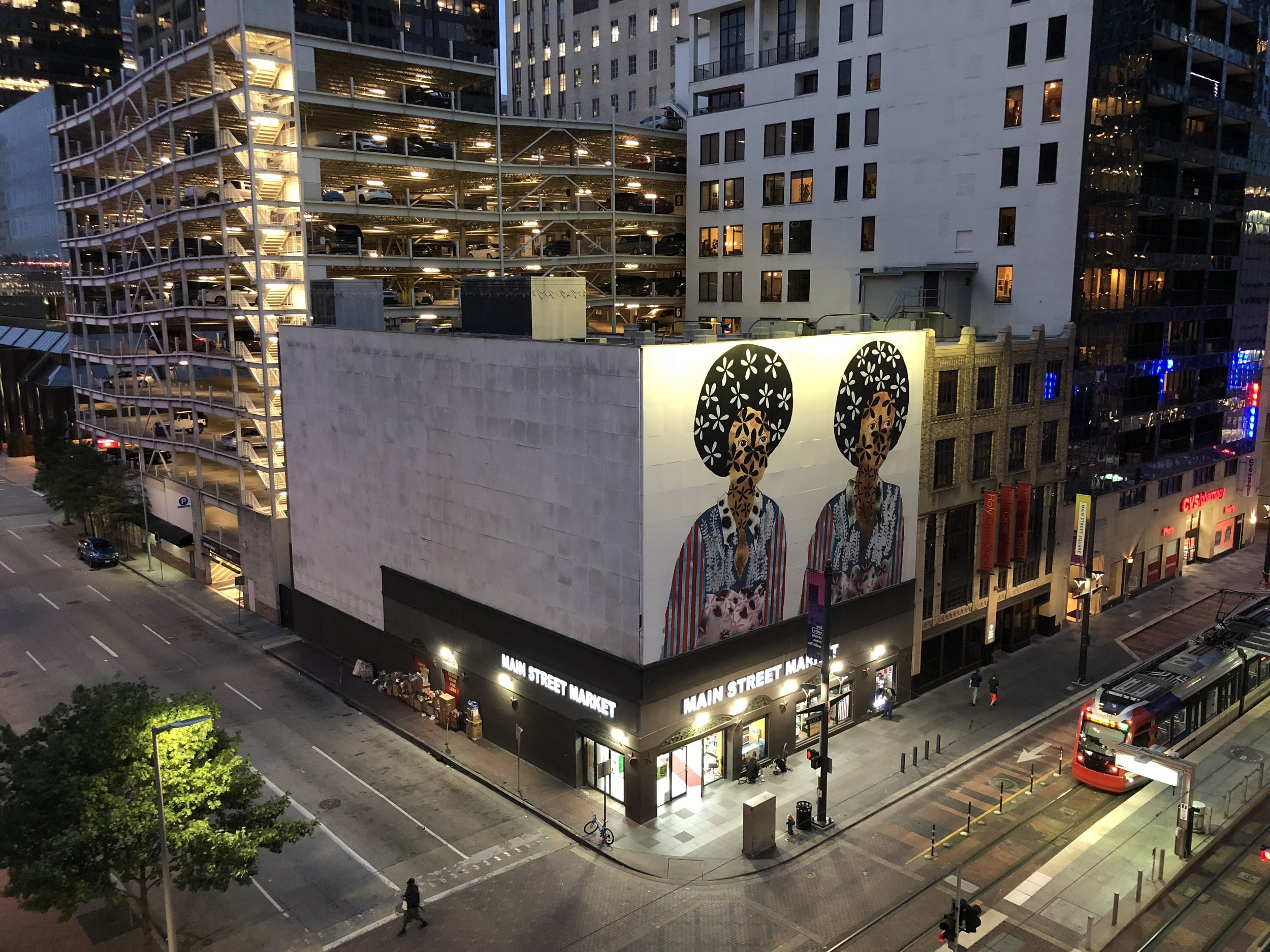 Jasmine Zelaya,  Twins  Main Street Marquee Night View,, 2018, 40' x 60' (vertical x horizontal) Vinyl affixed on the Façade of 901 Main Street in downtown Houston's Main Street Square. Photo Credit: Morris Malakoff