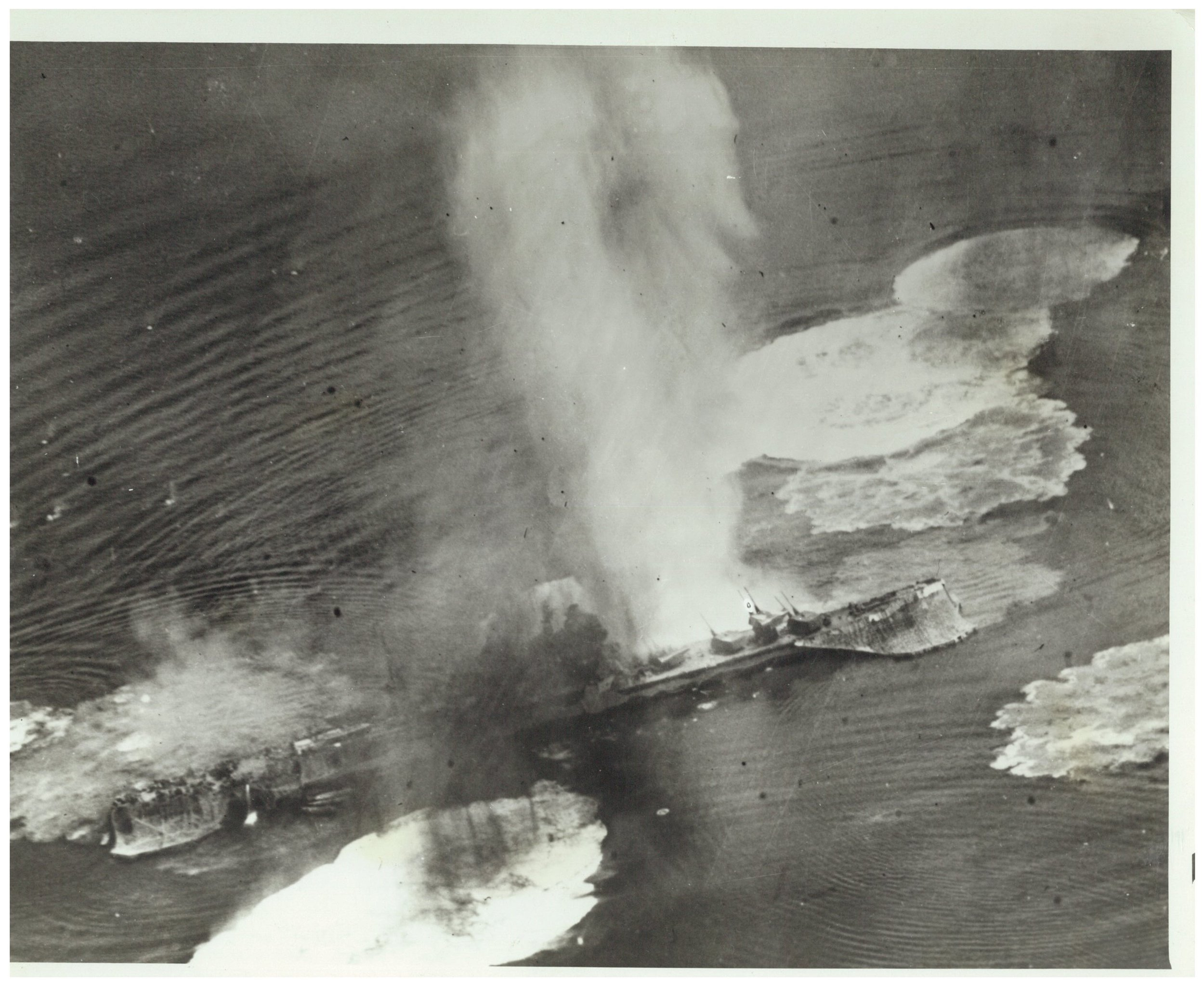 "The heavy cruiser   Tone   ,  on 24 July 1945. Raymond Porter and Normand Brissette were brought down while bombing the  Tone  on 28 July. Having flown into a horrific ""box"" of flak, at least one of the B-24 planes in the 6th Squadron of the 494th USAAF attack of 28 July reported that they diverted from their bomb run on the  Haruna  and instead attacked the  Tone  (viz. correspondence to Emil Turek from Van Curen, courtesy Barbara English, Turek's daughter)."