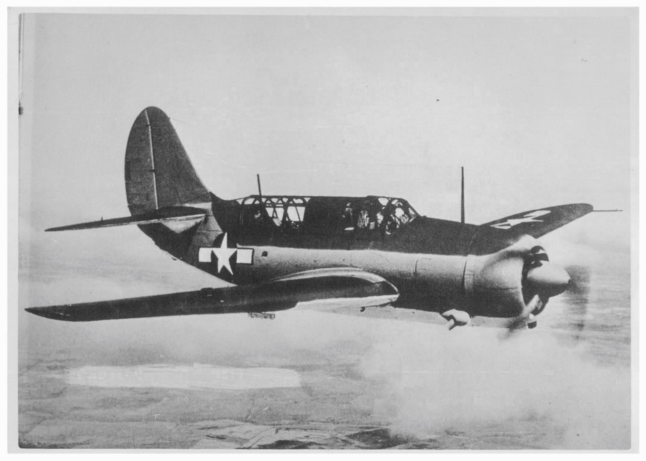A Curtiss SB2C Helldiver ,  the same model as the one flown by Raymond Porter and Normand Roland Brissette, who   made an emergency landing on the sea being hit by the anti-aircraft fire while attacking the Heavy Cruiser  Tone .