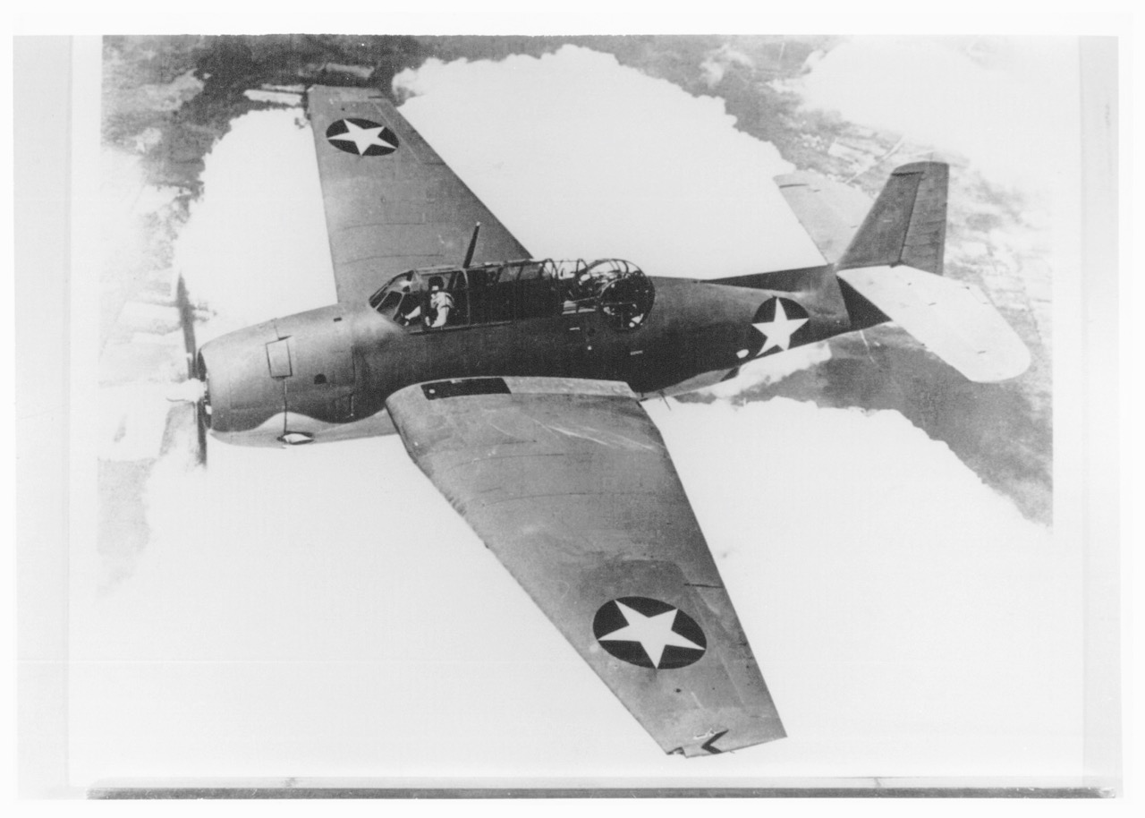 A TBM Avenger torpedo bomber, the same model as the one flown by Brown and Lockett, hit by anti-aircraft fire of the  Haruna  and fell into the sea around 3 p.m., 28 July.