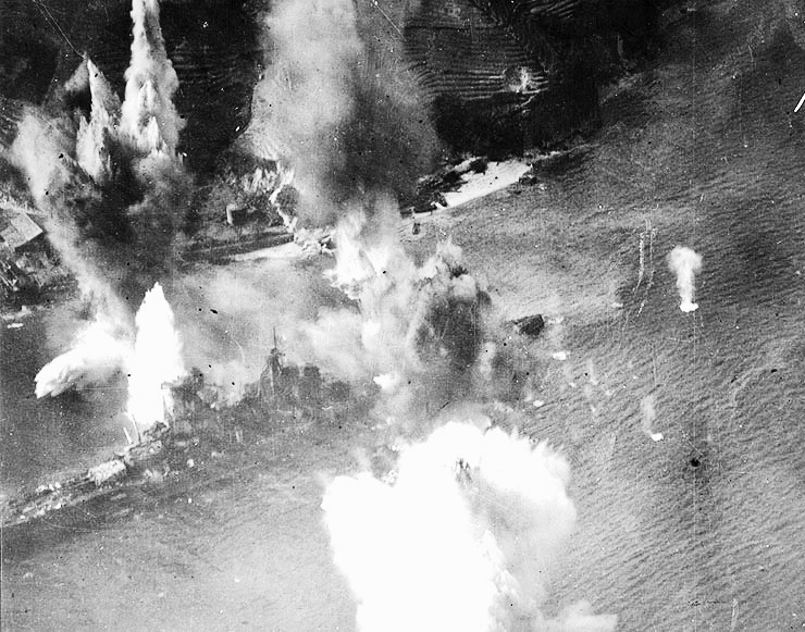 The Battleship  Haruna , being bombarded on July 28, 1945 by the carrier planes of the US Navy, off the shore of Koyo, Etajima, where she had been moored. The crew fought back with machine guns and high-angle guns; however, by evening the ship was resting on the bottom. On this day, two B-24 bomber planes, the  Lonesome Lady  and the  Taloa , as well as twenty aircraft carrier planes of the US Navy were shot down by the Japanese Forces.