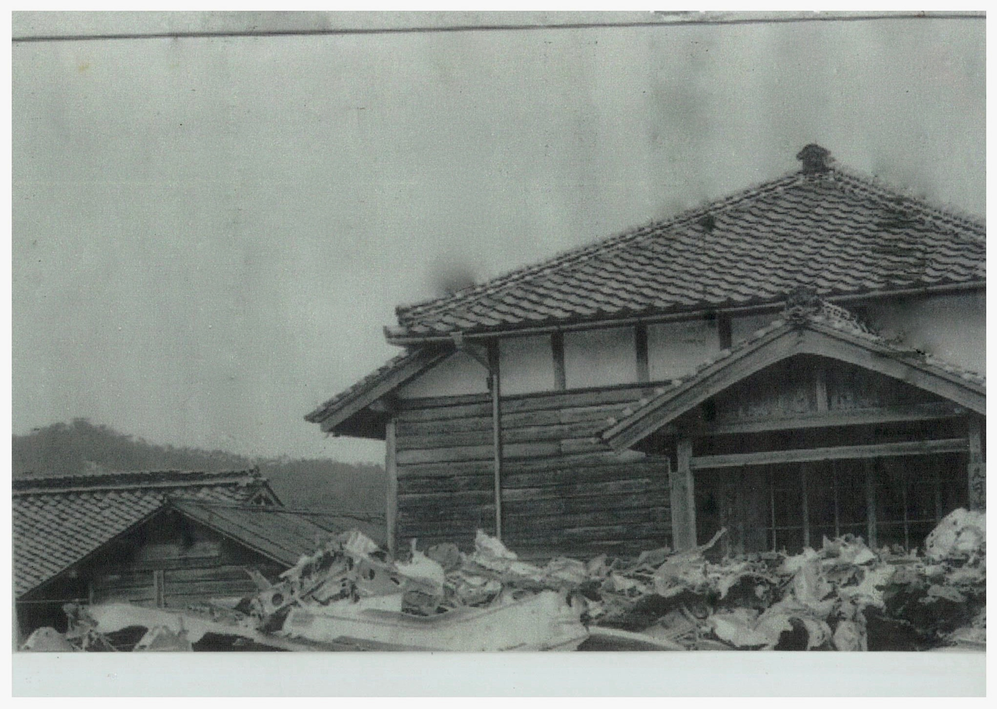 This traditional wooden structure is the Public Hall of the Ikachi Village, Kuga County, Yamaguchi Prefecture. As seen here, and as ordered by the GHQ, the wreckage of the  Lonesome Lady  was gathered and stacked into a large debris pile by villagers in front of the Hall along the national road, around 800m away from the crash site. (Photo courtesy of Mr. Yozo Kudo).