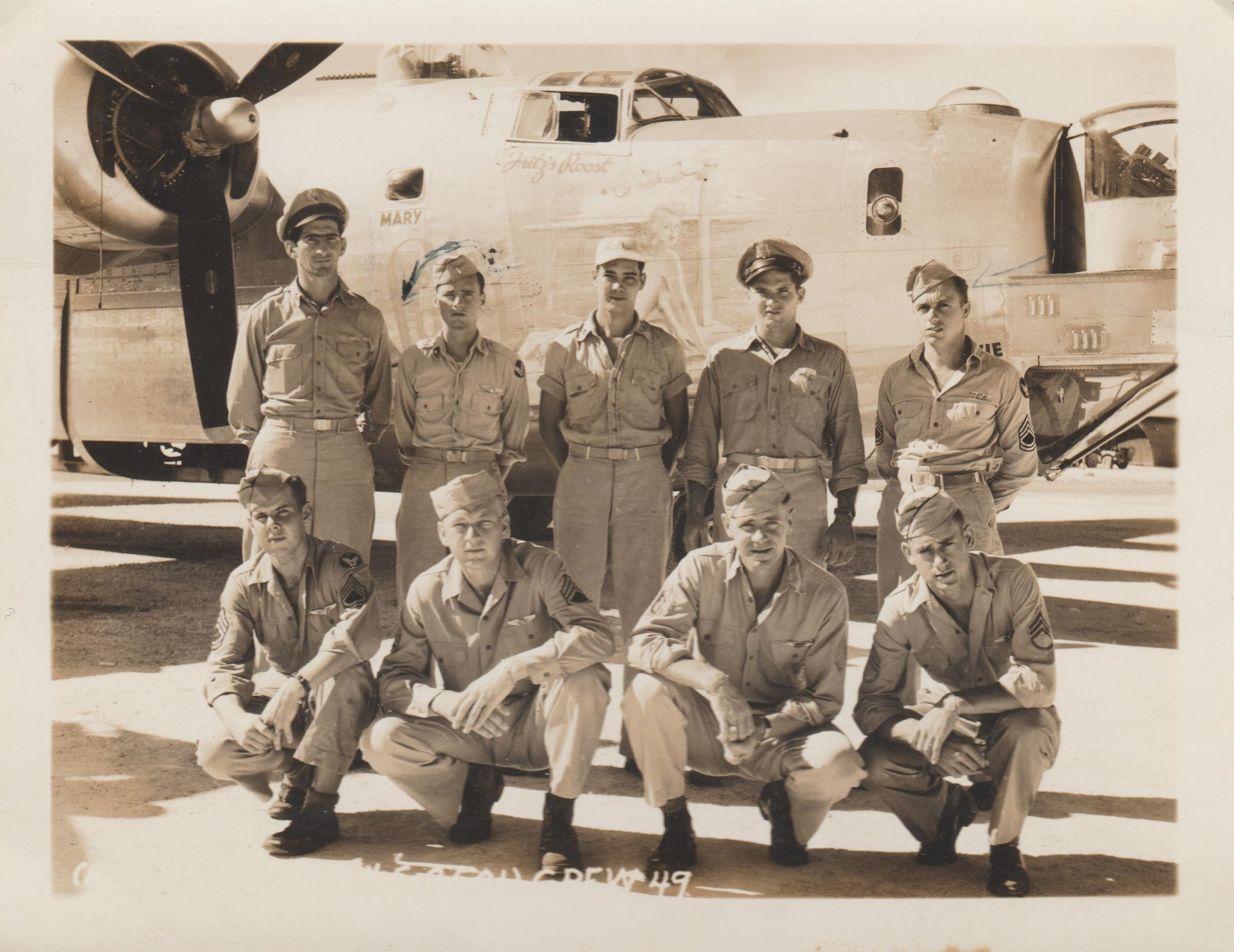 Joseph Dubinsky's veteran crew flew the  Taloa  on the  Haruna  mission, Group Mission #138. In this copy of the crew photo from the Co-pilot's great-nephew, Michael Flanagin, the men of Crew #49 are posed in front of the nose art of the  Lonesome Lady . (left to right)   Standing:  1st Lt. Joseph Dubinsky (Pilot); 2nd Lt. Rudolph C. Flanagin (Co-pilot); 2nd Lt. Lawrence A. Falls, Jr. (Navigator); 2nd Lt. Robert C. Johnston (Bombardier); T/Sgt Walter Piskor (Engineer)   Kneeling:  David. A Bushfield (Radio operator); Camilous P. Kirkpatrick (Waist Gunner); Charles C. Baumgartner (Lower Ball Turret Gunner); Charles C. Allison (Upper Turret Gunner); Not pictured: Julius Molnar (Tail Gunner). Not pictured here was Capt. Donald Marvin, an observer on his 40th combat mission who piloted most of the  Taloa  missions.