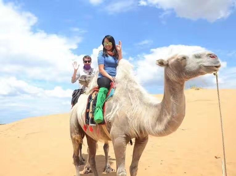 Nikka and I camel trekking through the Gobi Desert.