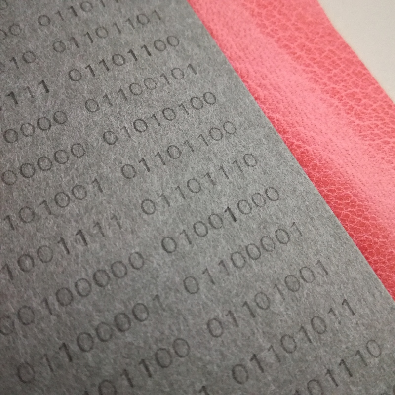 typewritten binary code endpapers + pink leather joints - fine binding - work in progress by Kaija Rantakari / www.paperiaarre.com
