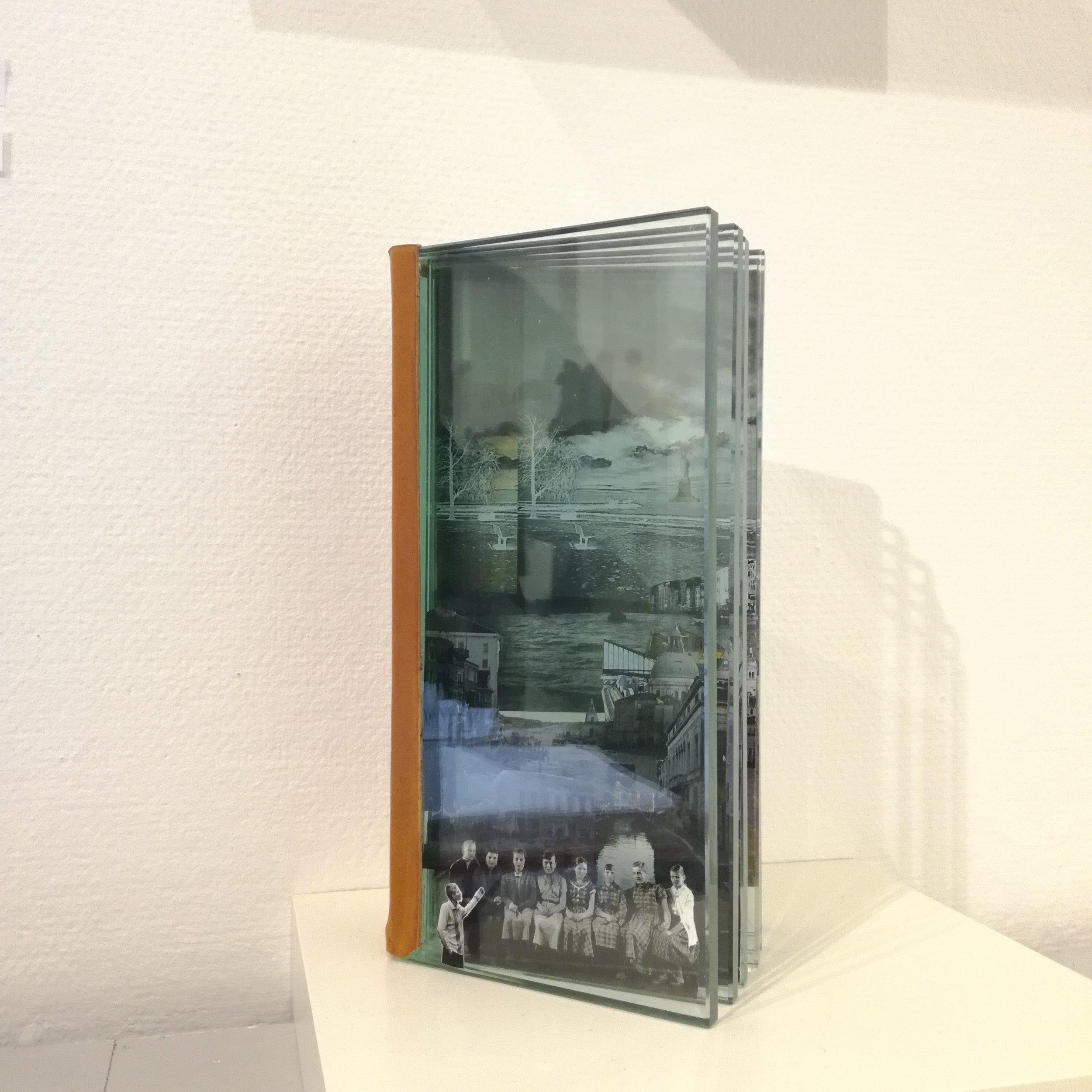 Taiteilijasukupolvi, 2017, by Rauni Hulke glass, paper, glue, oil paint - 26x14x6cm