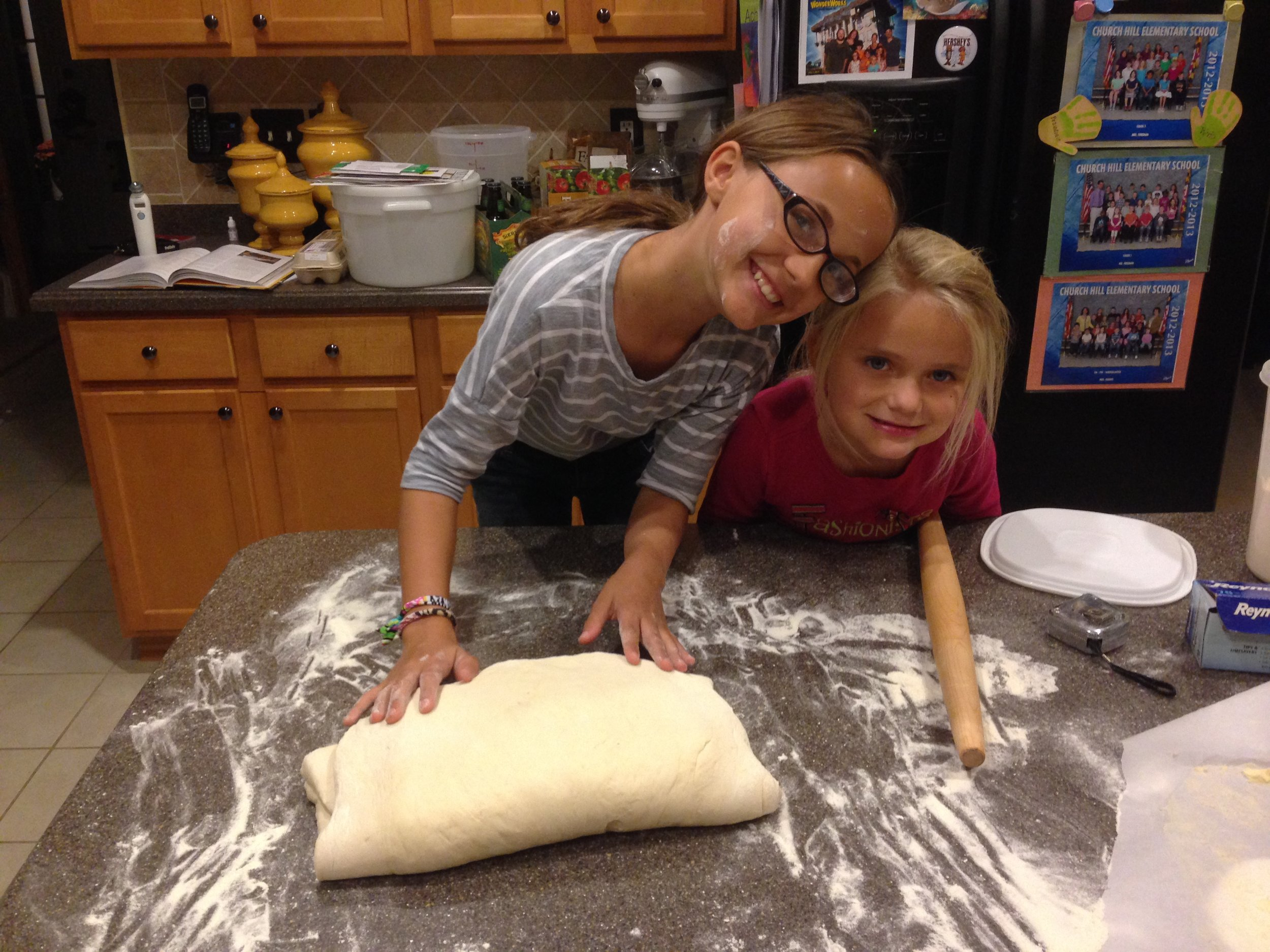 Brianna and Alyssa making croissants
