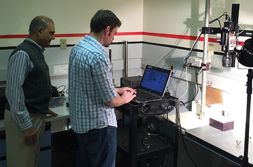 Dr. Trivedi (left) and Brimrose Research Engineer Sterling Walsh evaluate a culture sample using an acousto-optic tunable filter hyperspectral imager.