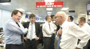 Rupert Murdoch speaking to journalists next to The Sun's 'Back Bench'