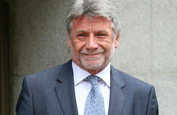 Smiling: Neil Wallis outside the Old Bailey after being cleared of phone hacking
