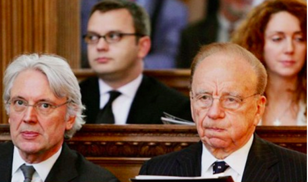 Rupert Murdoch sits alongside Les Hinton. Andy Coulson and Rebekah Brooks look on. Picture: Getty