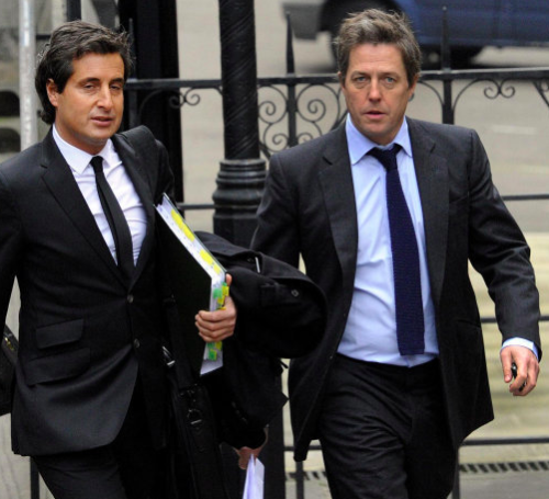 Smeared? Actor Hugh Grant (r) arrives at the Leveson Inquiry with barrister David Sherborne.