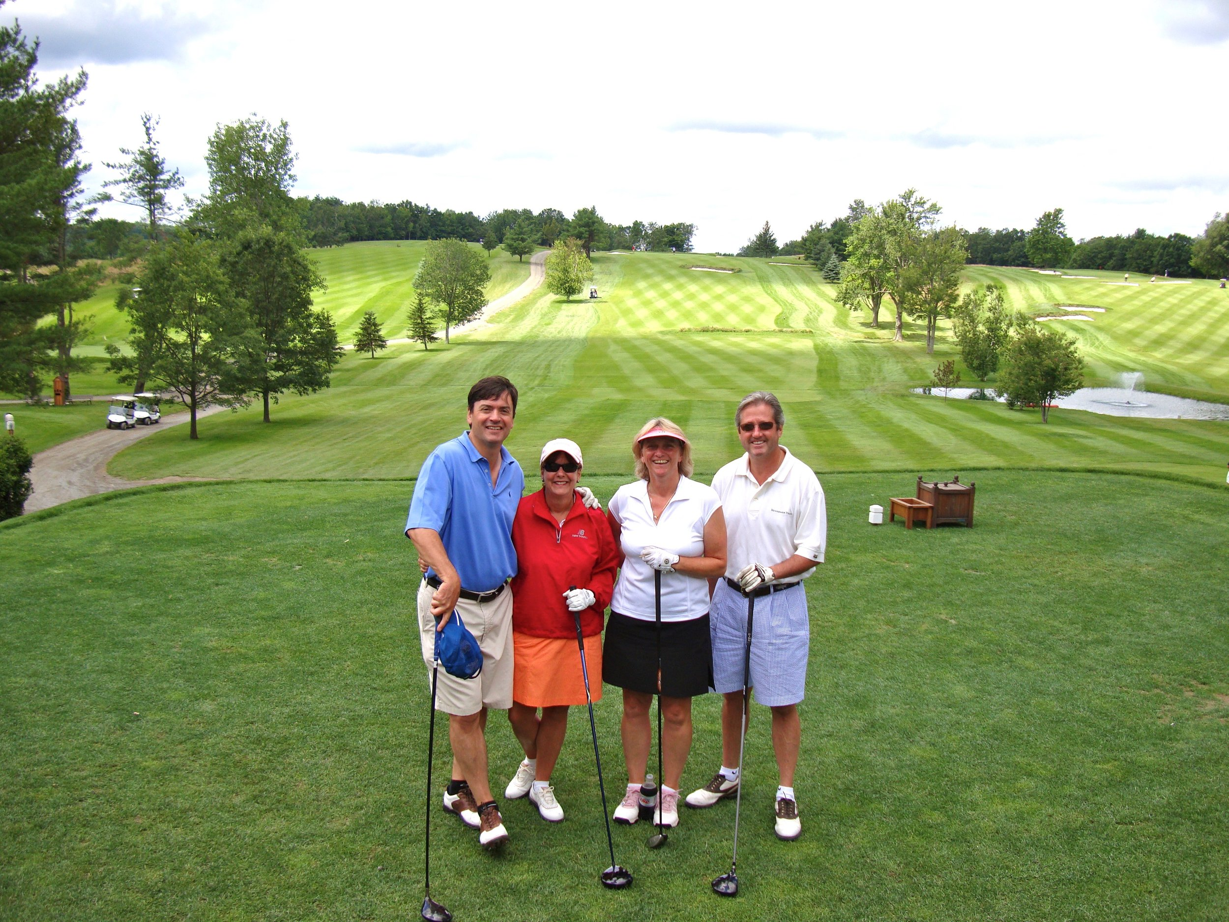 With our dear friends Clarke and Trish at the opening hole.