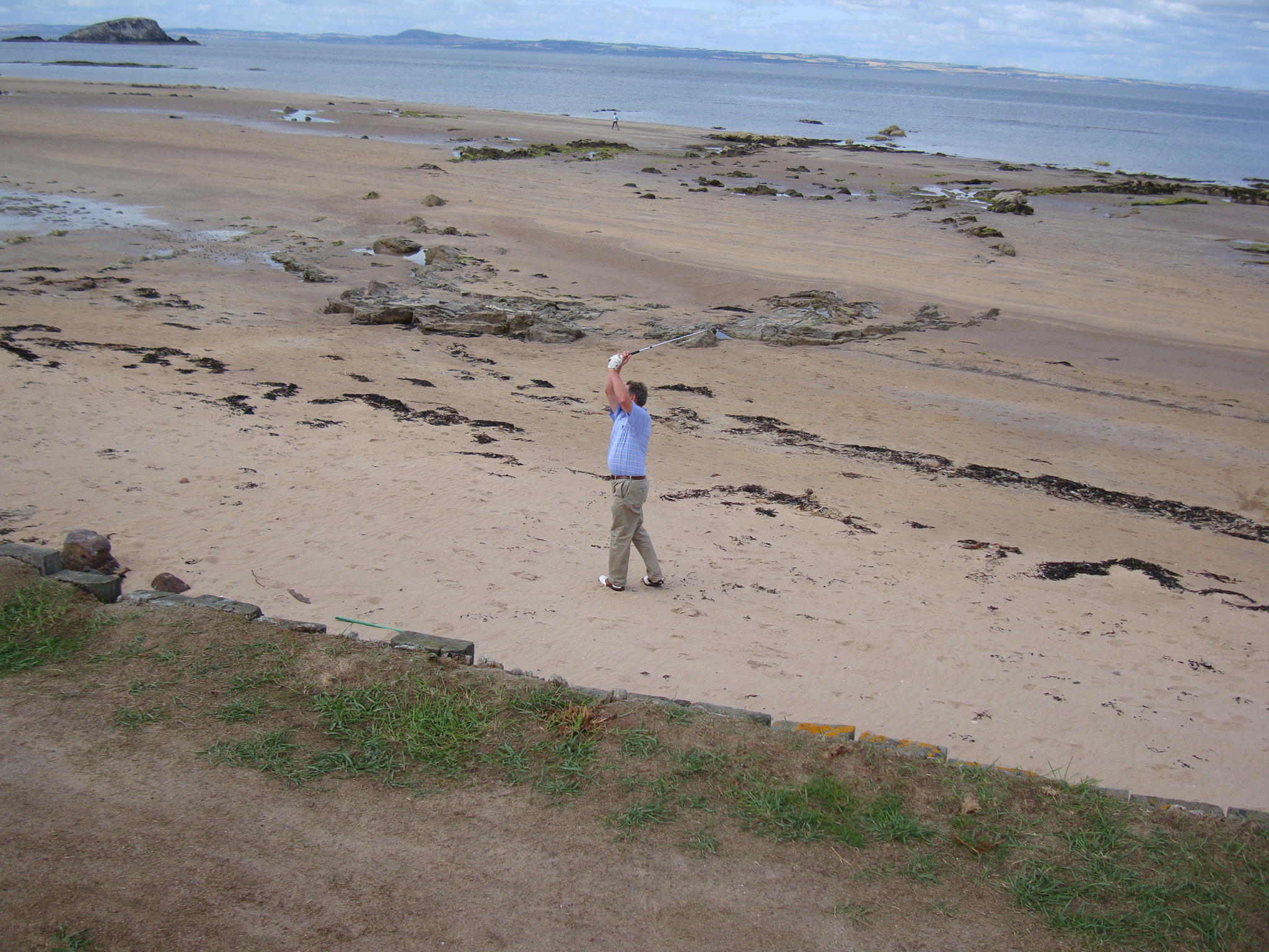 My cousin Pat's husband Alan Phillips playing from the beach at number 2 in 2010.