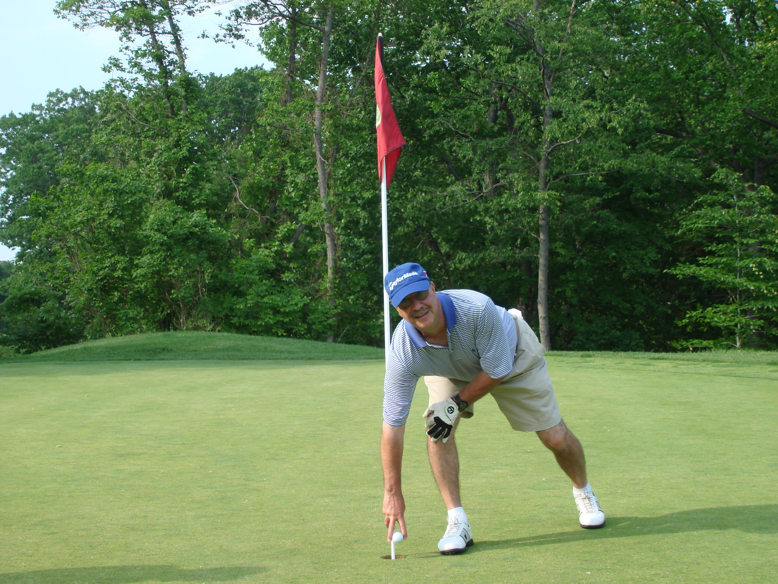 My dear friend Fred Cuccia, a former President who did more to restore BBCC than anyone, deservedly retrieve's the ball from a hole in one on 15. 2010.