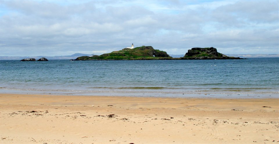 This is the Fidra Island and Lighthouse.  The island's name is believed to be  Old Norse  in origin, referring to the large number of bird feathers found there. Like the nearby  Bass Rock , it has a substantial  seabird  population, and is now an  RSPB  reserve.  Robert Louis Stevenson  often visited the beaches at the area known today as Yellowcraig and it is said that he based his map of   Treasure Island   on the shape of Fidra.