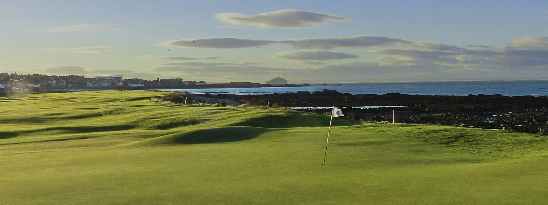 Pretty good image that captures the narrowness pf the course and proximity to the sea. Bass rock way in the distance at North Berwick.
