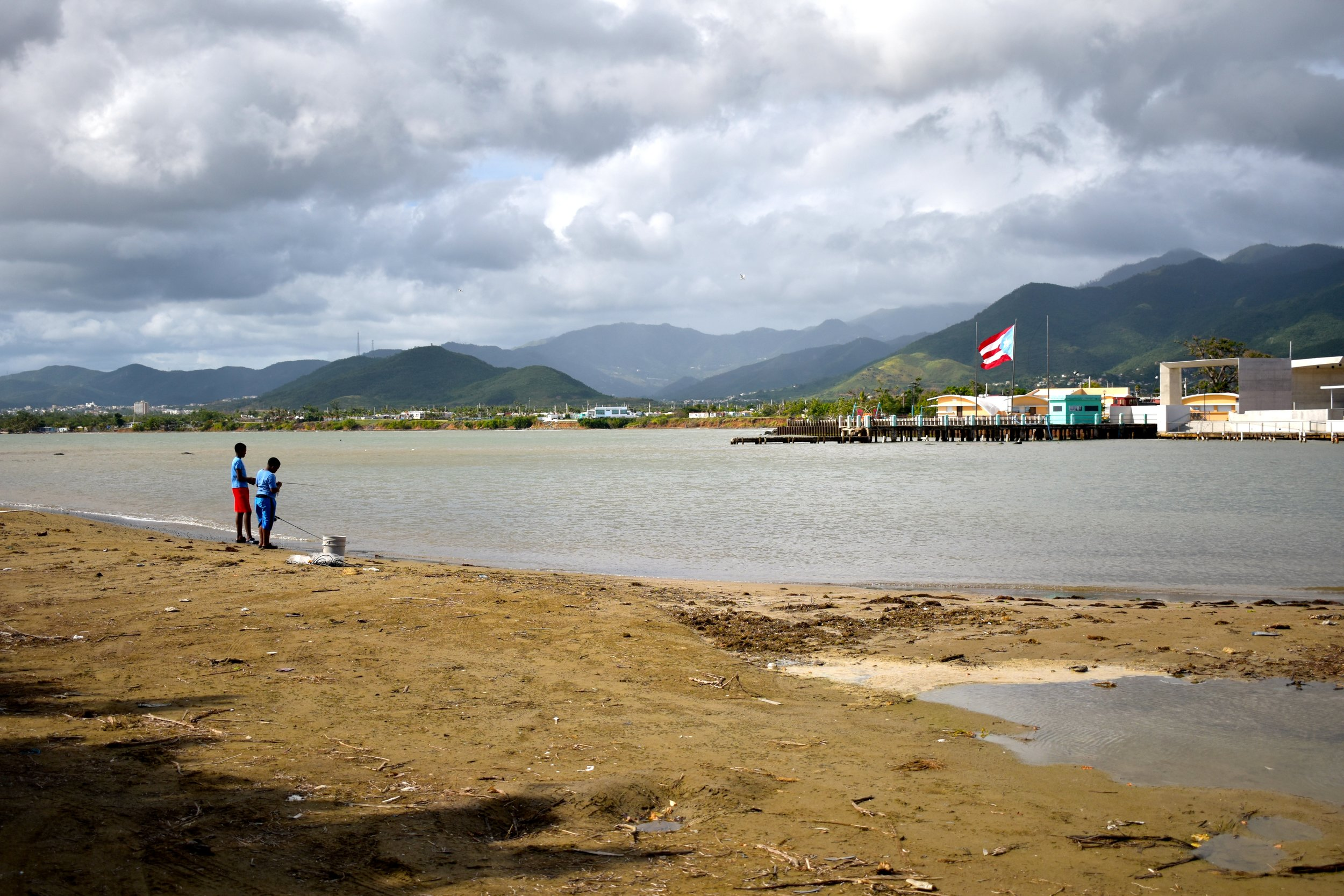 (Photo: Boys Fishing in Arroyo, Puerto Rico, Hilda Lloréns)