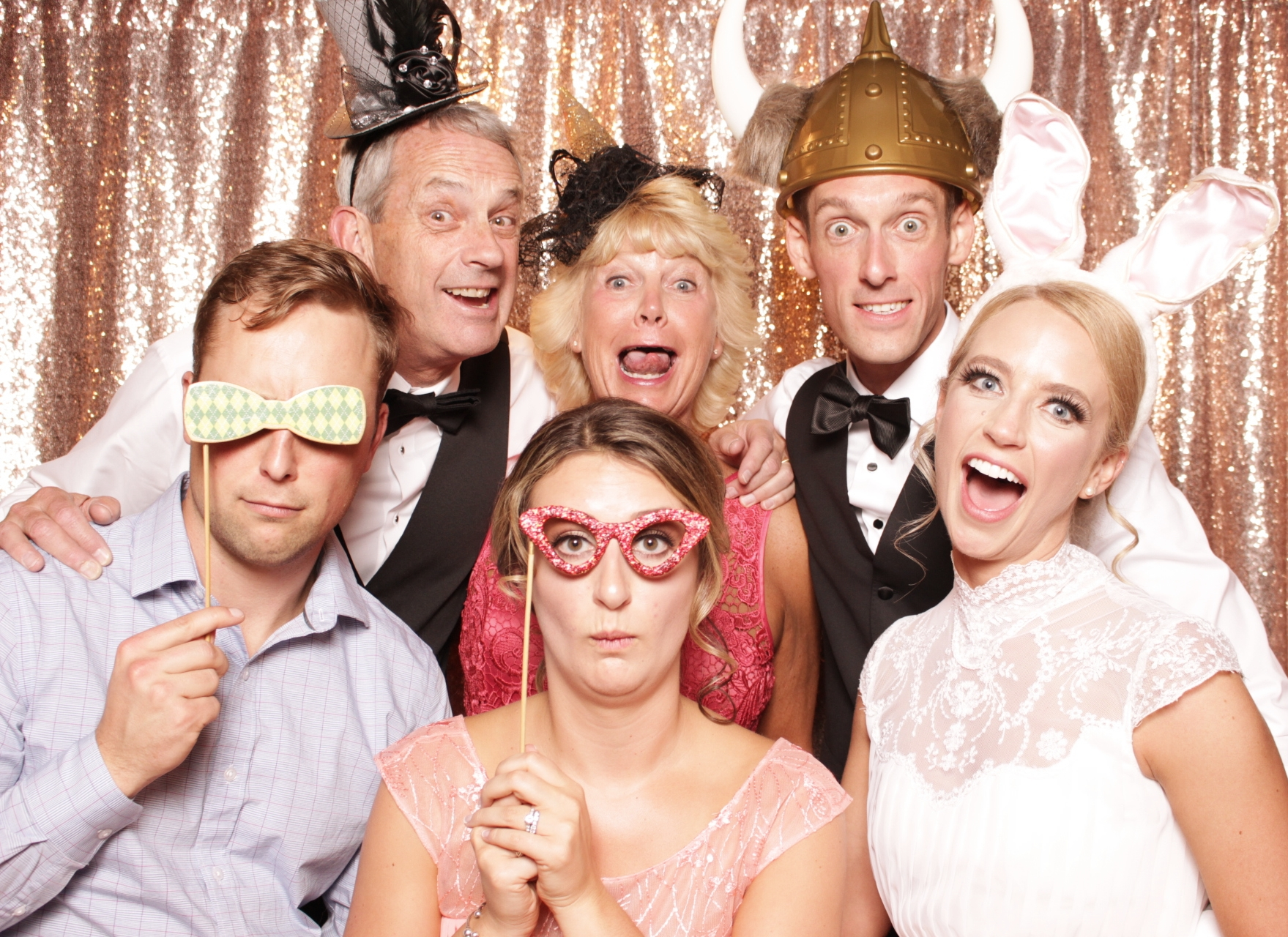 WACKY WEDDING FUN AT tWIN OWLS STEAKHOUSE IN ESTES PARK WITH SPARKLY ROSE GOLD BACKDROP