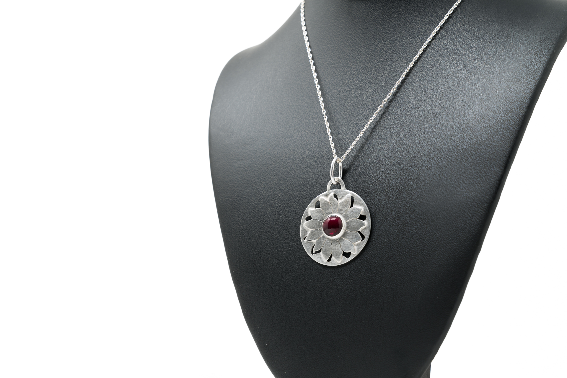 Sunflower Pendant   This beautiful commission piece is made of Sterling Silver with a set Garnet and is not available for sale.  November 2017