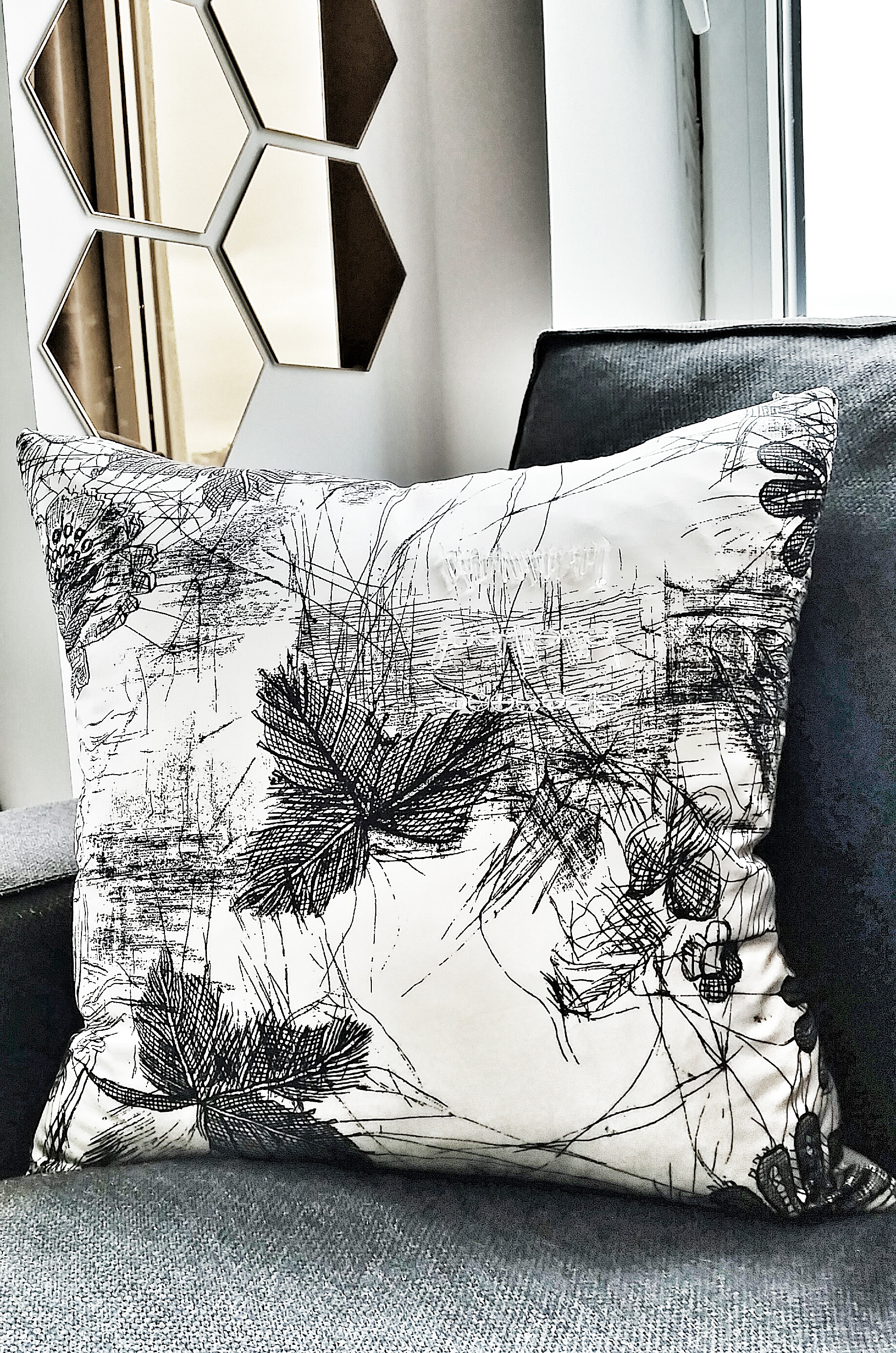 Designer silk pillow with raw quartz crystal