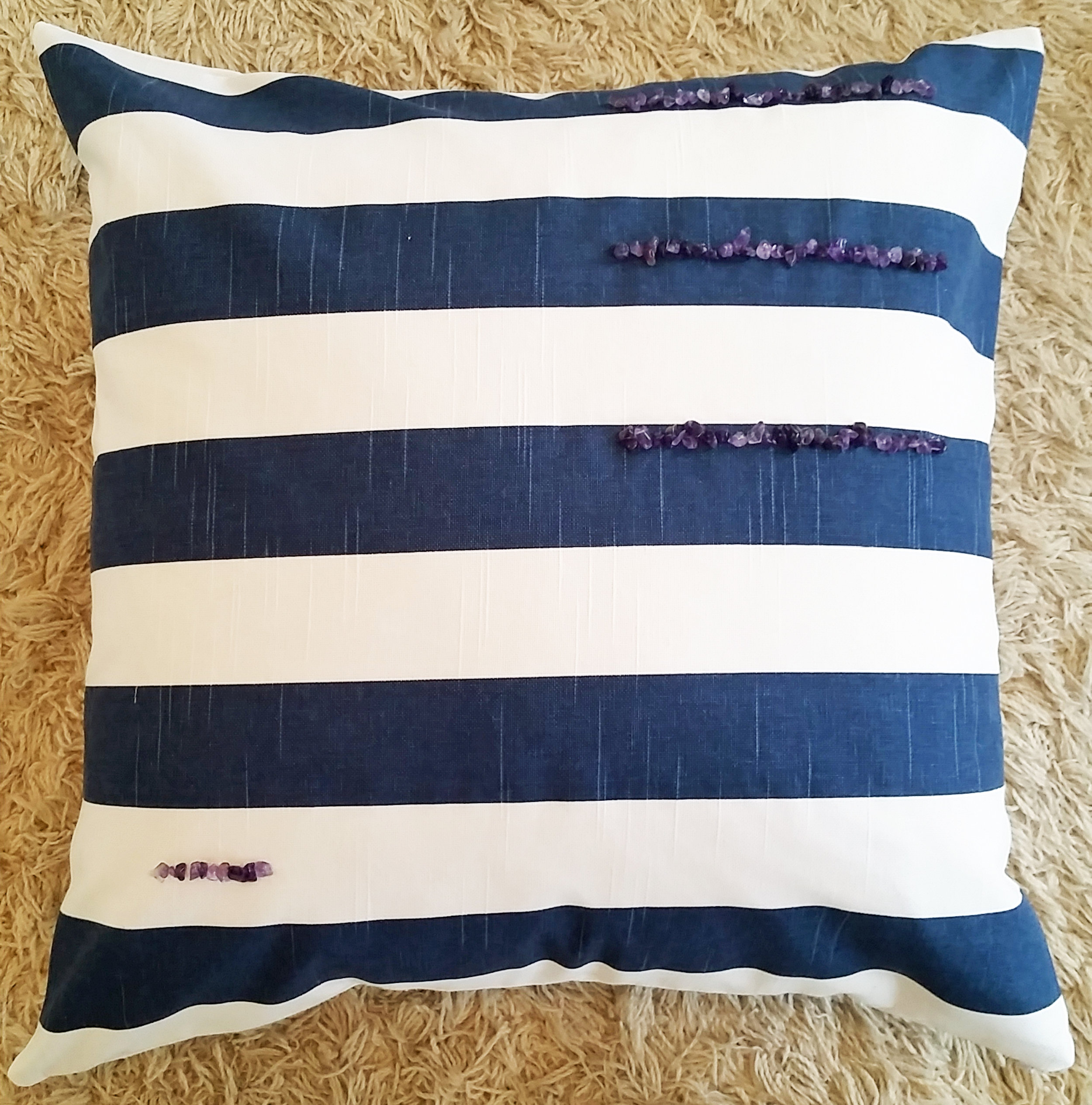 Blue and white striped pillow with Amethyst will help with relaxation for a good night sleep!