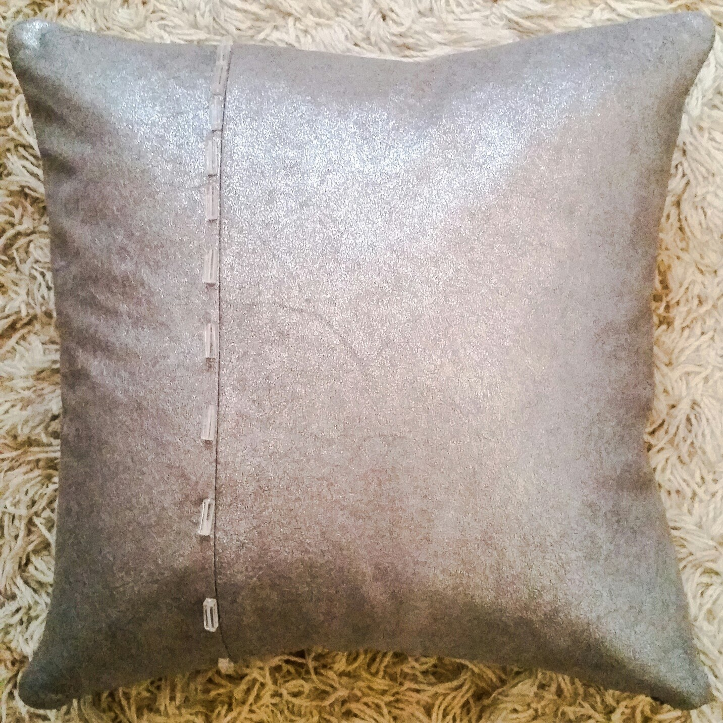 Metallic Grey pillow with rectangle pieces of quartz