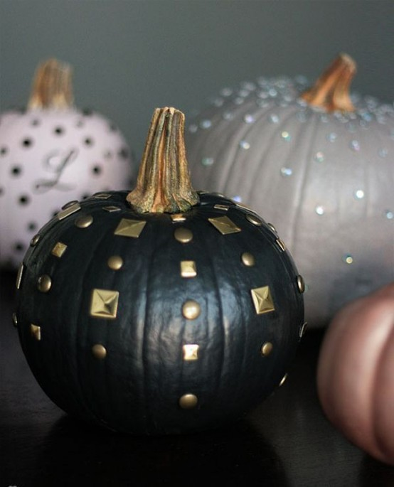 Use different materials to decorate your pumpkins.  You can use tacks, sequins, glitter, metallic paints, nail heads, spikes, and pretty much anything you can glue or stick on to it.